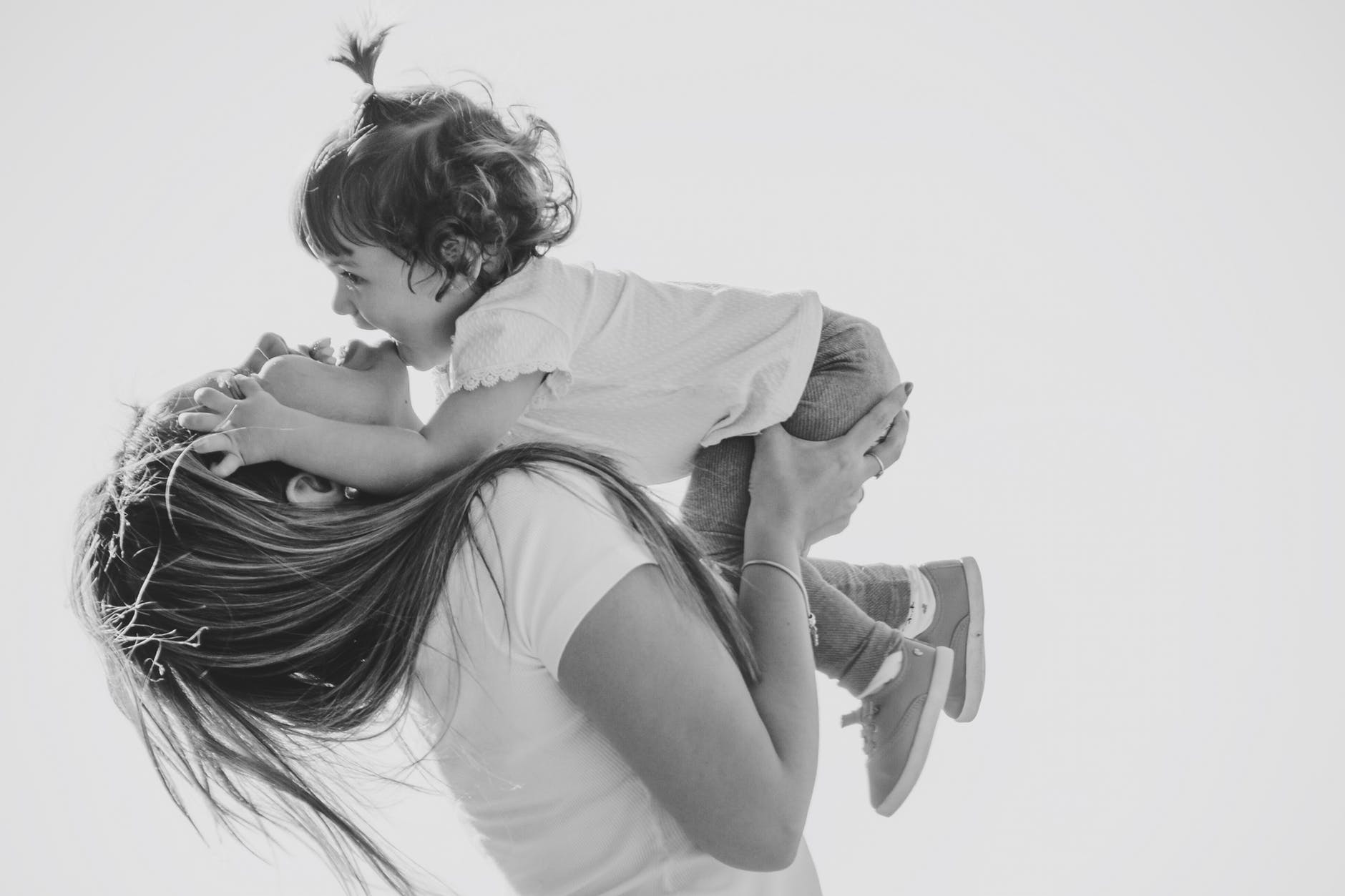 photo of woman holding her child